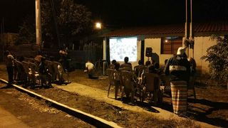 Showing the Jesus Film in a neighborhood